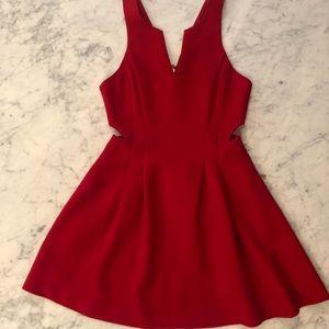 BCBG red mini dress with cutouts